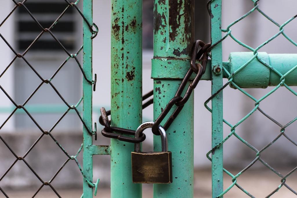 padlock green fence